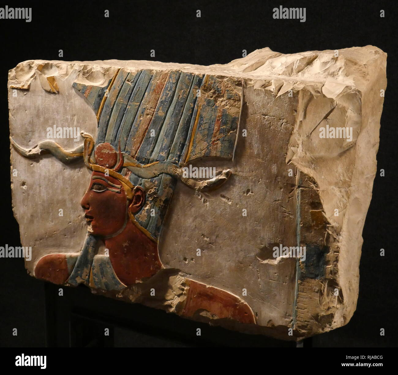painted limestone relief depicting Amun-Min; New Kingdom; Deir el Bahri 1490-1436 BC. Amun was a major ancient Egyptian deity who appears as a member of the Hermopolitan Ogdoad. Min was an ancient Egyptian god whose cult originated in the Predynastic period - Stock Image