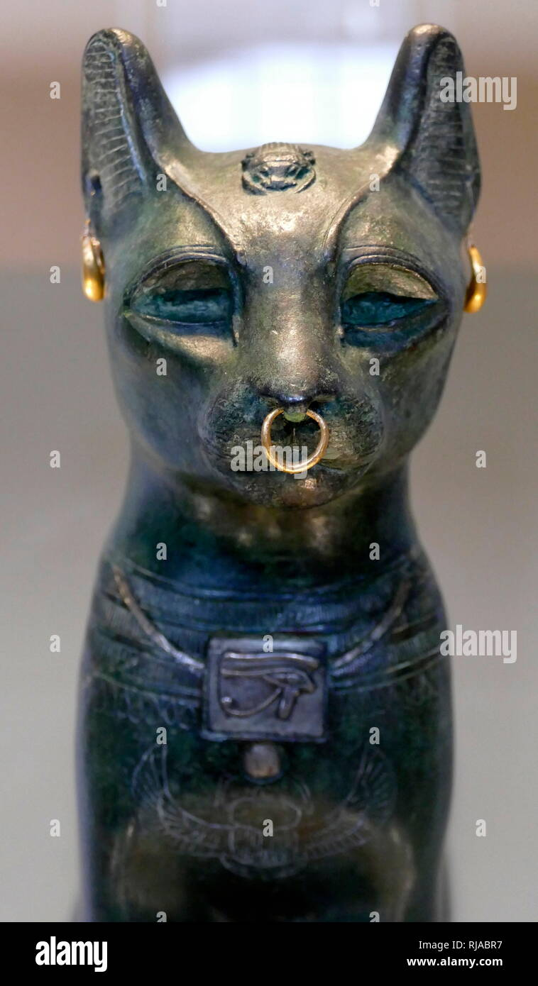 The Gayer-Anderson Cat is an Ancient Egyptian statue of a cat, which dates from the Late Period (around 664–332 BC). It is made of bronze, with gold ornaments. The sculpture is known as the Gayer-Anderson cat after Major Robert Grenville Gayer-Anderson. The cat wears jewellery and a protective wadjet amulet. A scarab appears on the head and a winged scarab is shown on the chest. - Stock Image