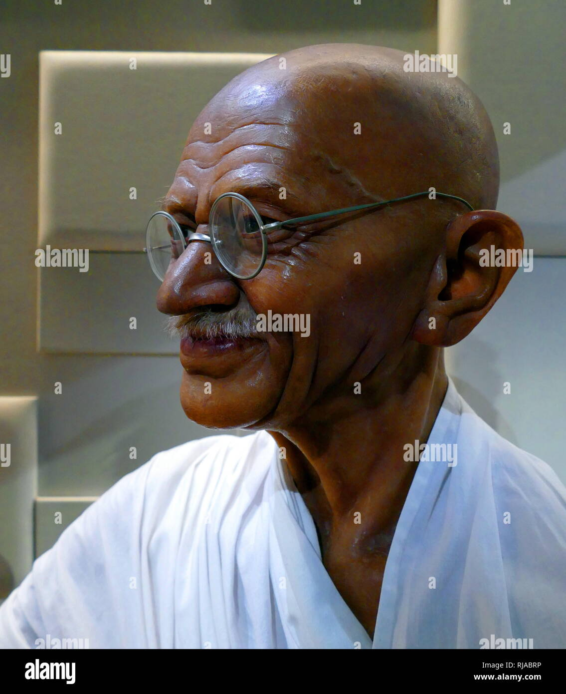 Waxwork figure of Mohandas Karamchand Gandhi, 1869-1948. Indian activist who was the leader of the Indian independence movement against British rule. Employing nonviolent civil disobedience, Gandhi led India to independence and inspired movements for civil rights and freedom - Stock Image