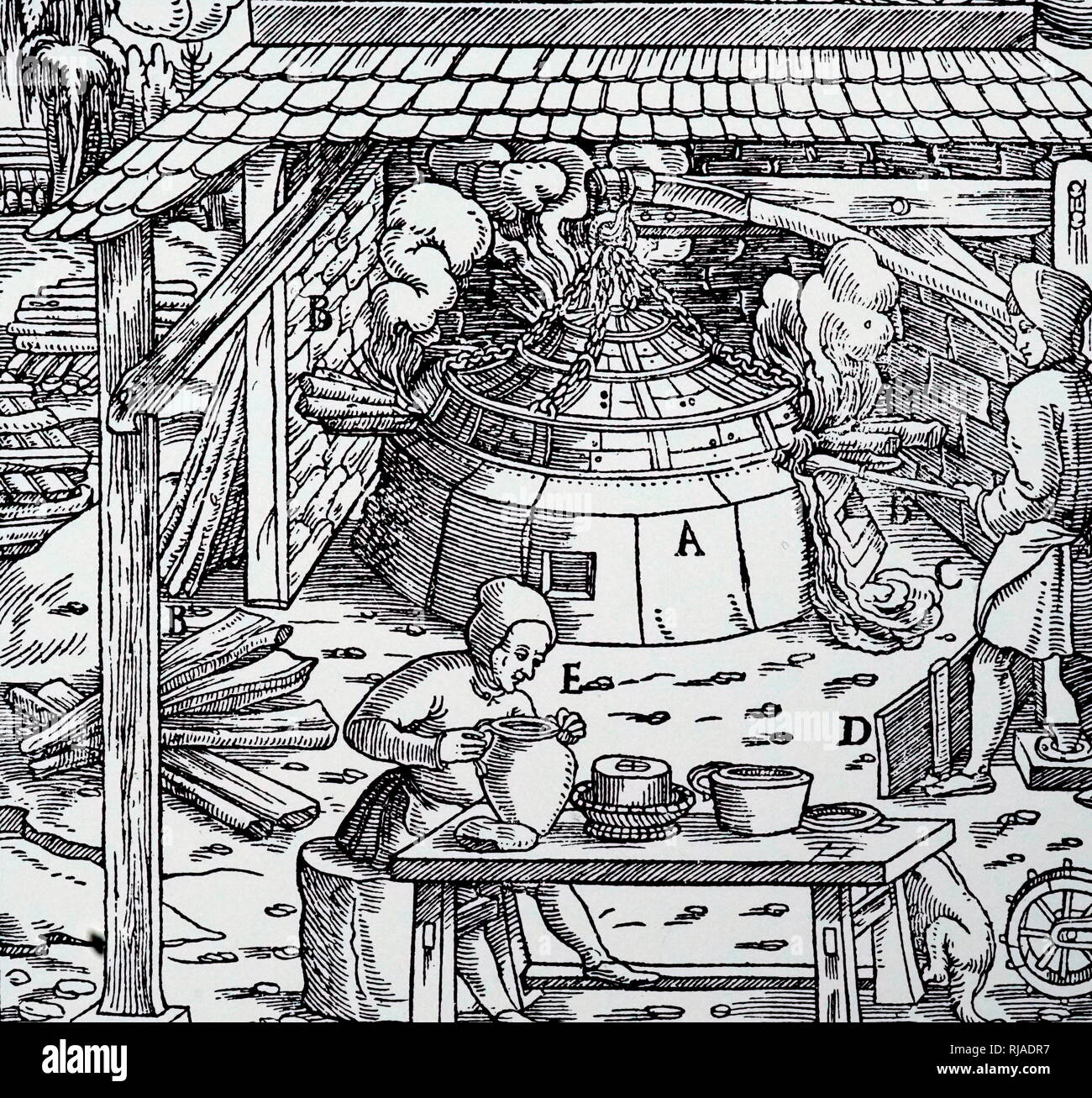 A woodcut engraving depicting the separation of lead from silver or gold in a cupellation furnace. Dated 16th century - Stock Image