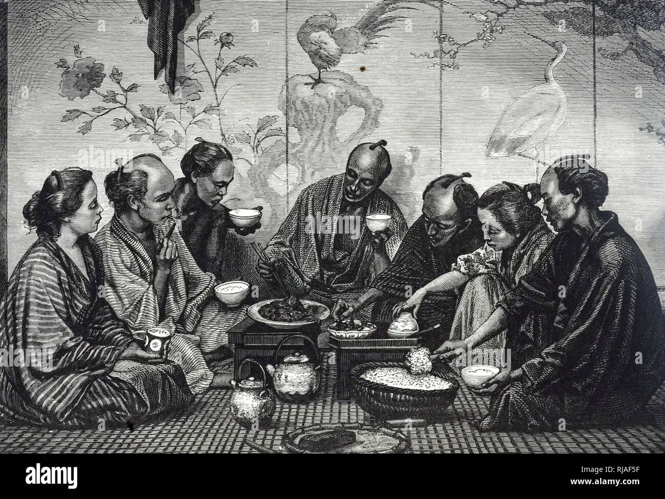 An engraving depicting a Japanese family eating a meal. Dated 19th century - Stock Image