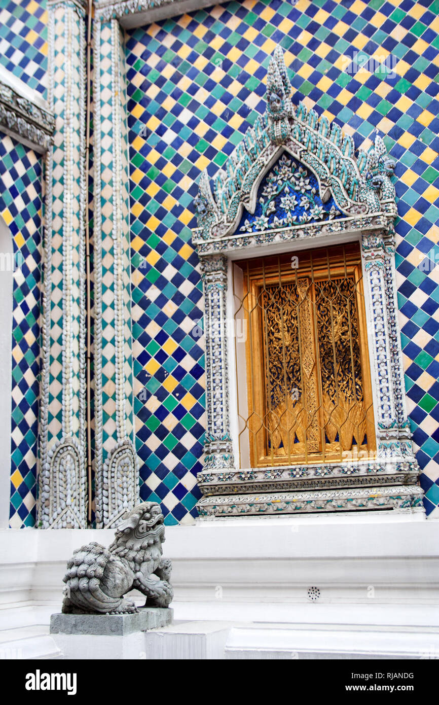 Sculpture and facade ornament detail of Gandhara Buddha Viharn chapel building in Wat Phra Kaew temple within Grand Palace complex in Bangkok, Thailan - Stock Image