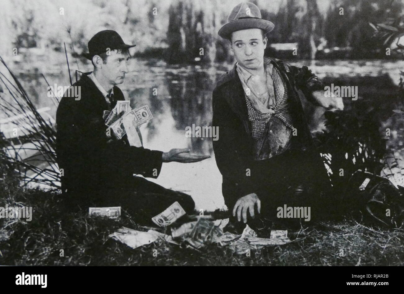 See America Thirst is a 1930 comedy film produced and distributed by Universal Pictures and directed by William James Craft. Silent comics Harry Langdon and Slim Summerville star along with silent actress Bessie Love. Though released late in 1930, it nevertheless had a silent version - Stock Image