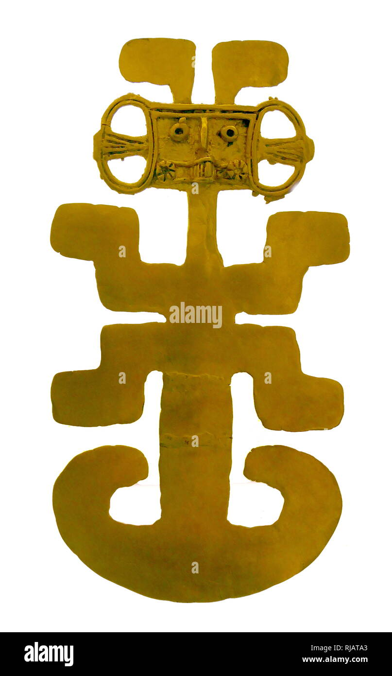 Gold Pectoral object depicting human to spiritual transformation. From Colombia, South America circa 900-1500 AD. Indigenous people inhabited the territory that is now Colombia by 12,500 BCE. Beginning in the 1st millennium BCE, groups of Amerindians including the Muisca, Quimbaya, and Tairona, traded gold until the Spanish conquest in the 15th -16th century. - Stock Image