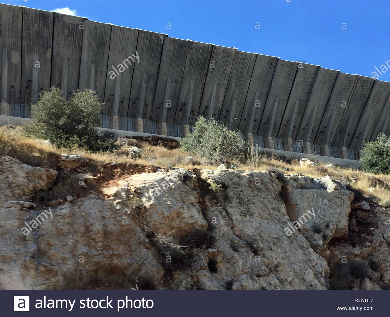 The Israeli West Bank barrier or wall is a separation barrier in the West Bank or along the Green Line. Israel considers it a security barrier against terrorism, while Palestinians call it a segregation or apartheid wall.  The barrier was built during the Second Intifada that began in September 2000, and was defended by the Israeli government as necessary to stop the wave of violence inside Israel that the uprising had brought with it - Stock Image