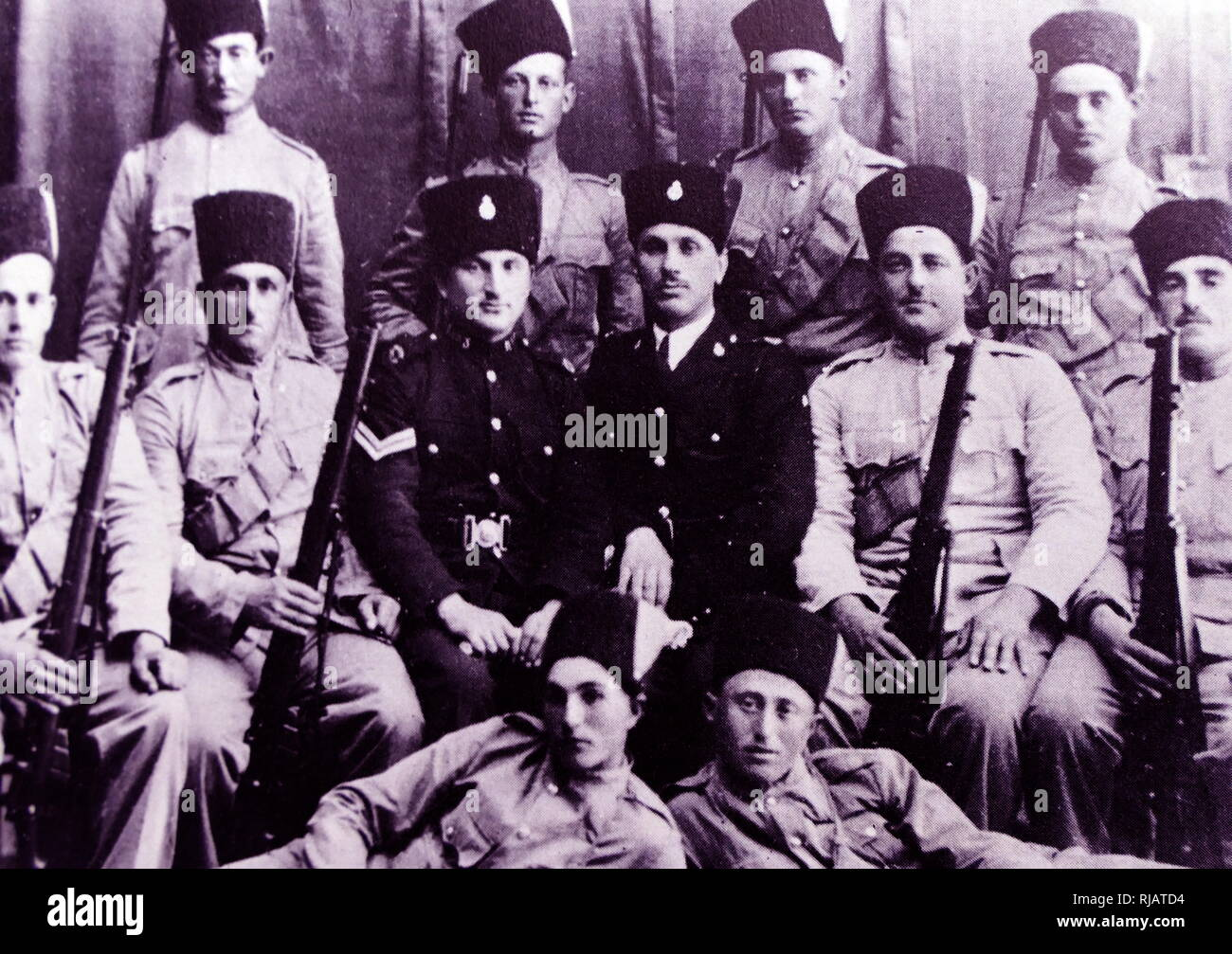 Yigal Allon (back row third from right) in a group of Jewish Settlement Police (JSP), a division of the Notrim established in Mandatory Palestine in 1936, during the 1936-39 Arab revolt. Yigal Allon (1918 - 1980) was an Israeli politician, a commander of the Palmas, and a general in the IDF. He served as one of the leaders of Ahdut HaAvoda party and the Israeli Labour party, and acting Prime Minister of Israel. - Stock Image