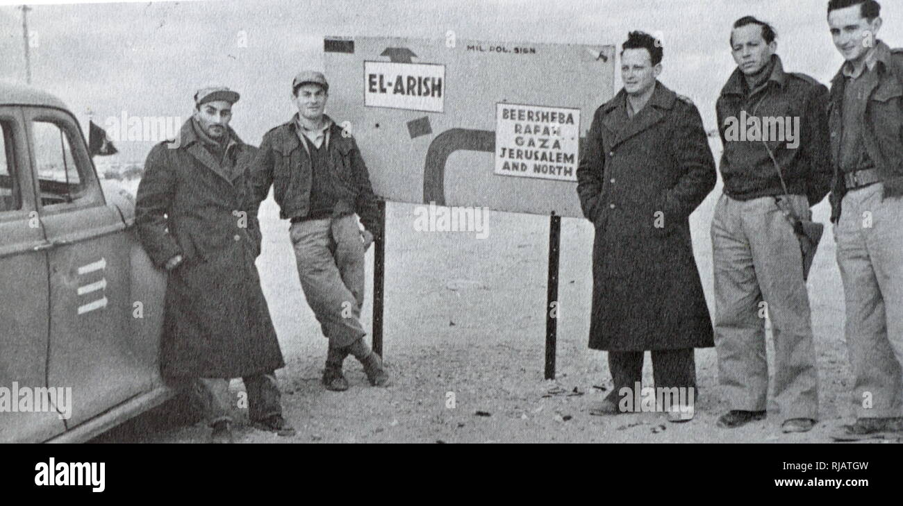 Yigal Allon (third from right) in a group of Israeli soldiers in Northern Negev during the Israeli War of Independence 1948. Yigal Allon (1918 - 1980) was an Israeli politician, a commander of the Palmach's, and a general in the IDF. He served as one of the leaders of Ahdut HaAvoda party and the Israeli Labour party, and acting Prime Minister of Israel. - Stock Image