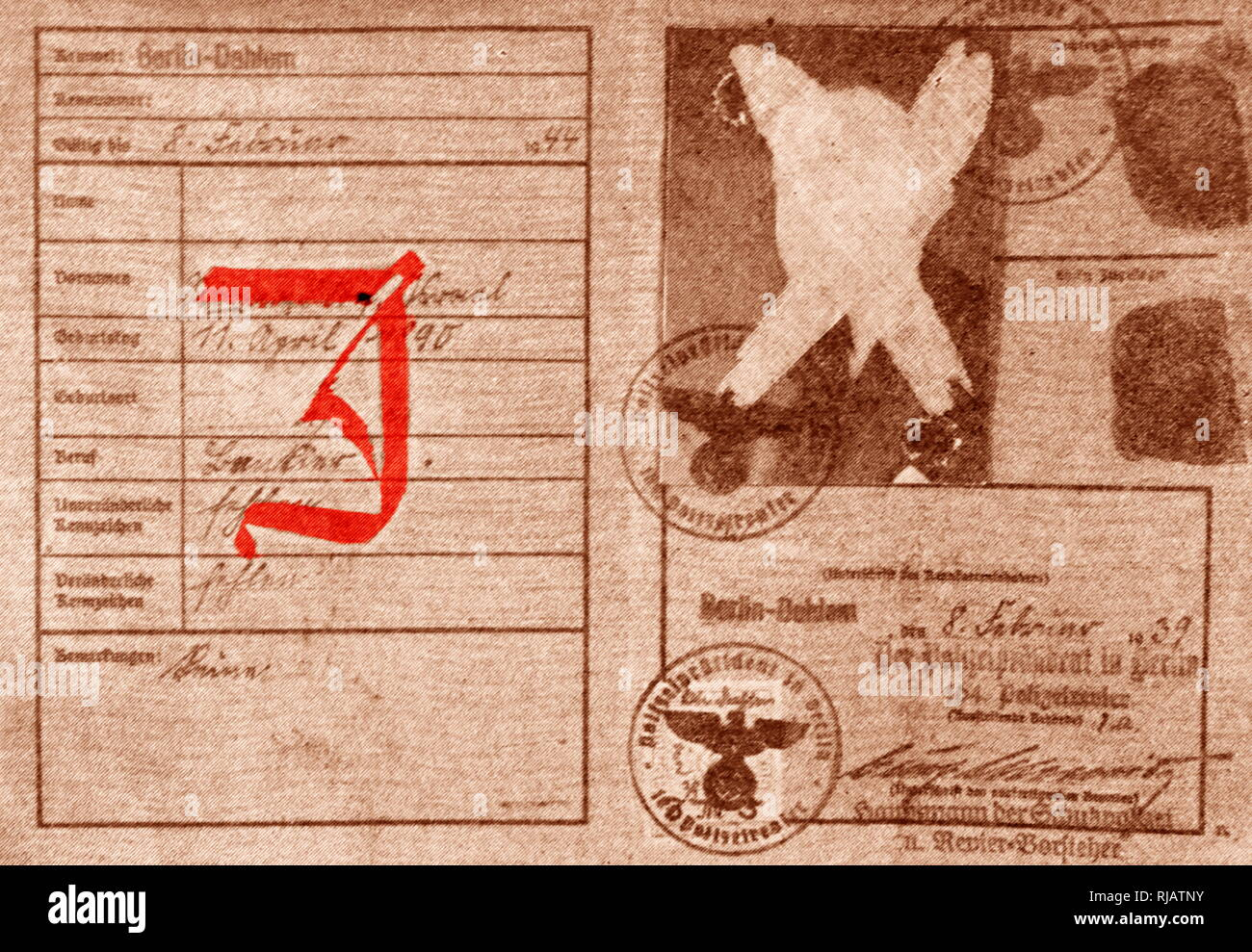 A special identity card with a red 'J' stamped on it further advanced the exclusion of the Jews in 1939.  All Jewish people had to carry an identity card after the enactment of the Nuremberg Laws (Nürnberger Gesetze); anti-Semitic laws in Nazi Germany, introduced on 15 September 1935. - Stock Image