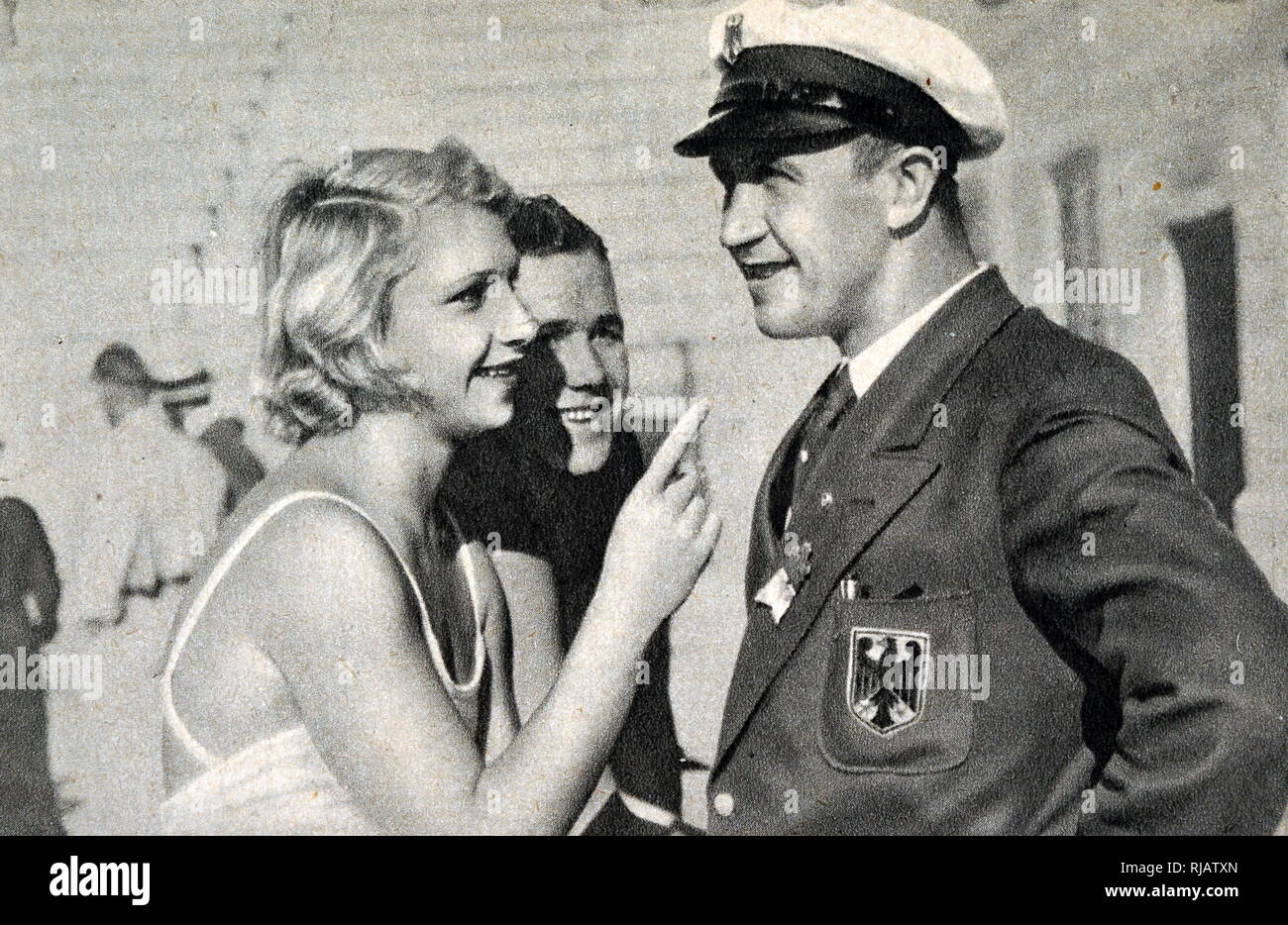 Photograph of Dorothy Poynton-Hill (1915 - 1995) with Germany's Joachim ('Aki') Rademacher (1906 - 1970) at the 1932 Olympic games. - Stock Image