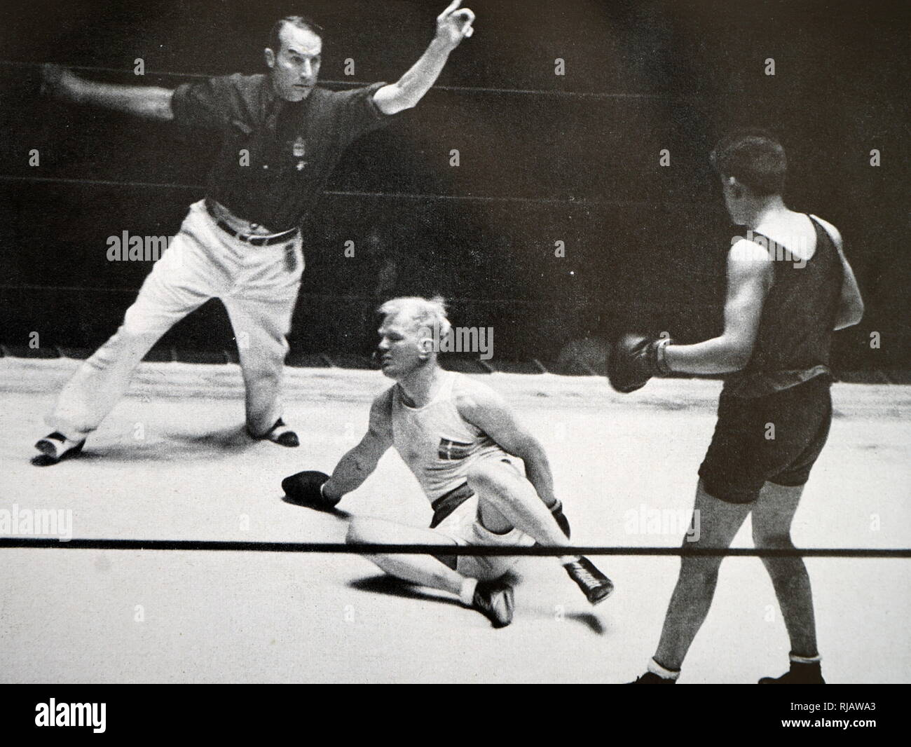 Photograph of David Daniel Carstens (1914 - 1955) from South Africa fighting Peter Oscar Jørgensen (1907 - 1992) from Denmark at the 1932 Olympic games. David Daniel Carstens takes gold in the Light Heavyweight division. Stock Photo