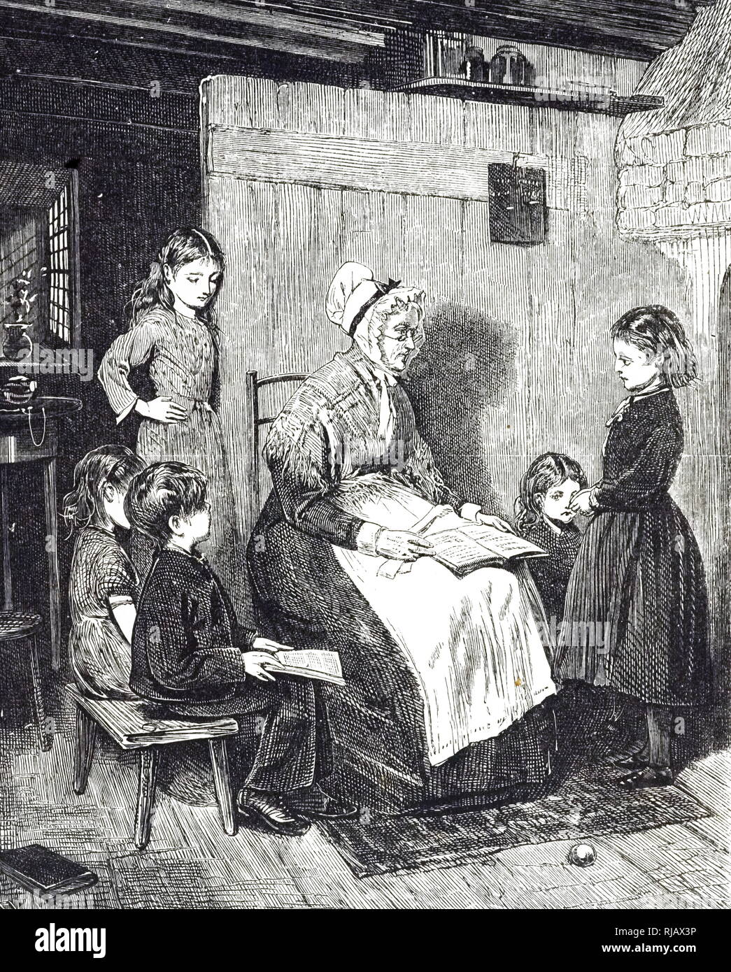 An engraving depicting a 'dame school' in England. These schools were run for working-class children and were often of an inferior educational standard. Dated 19th century - Stock Image