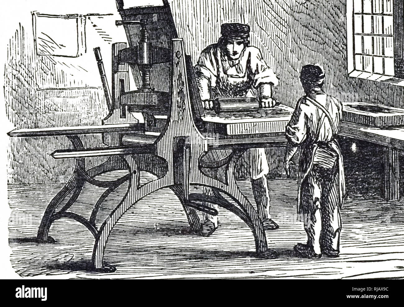 An engraving depicting a lithographic printing press. Dated 19th century - Stock Image