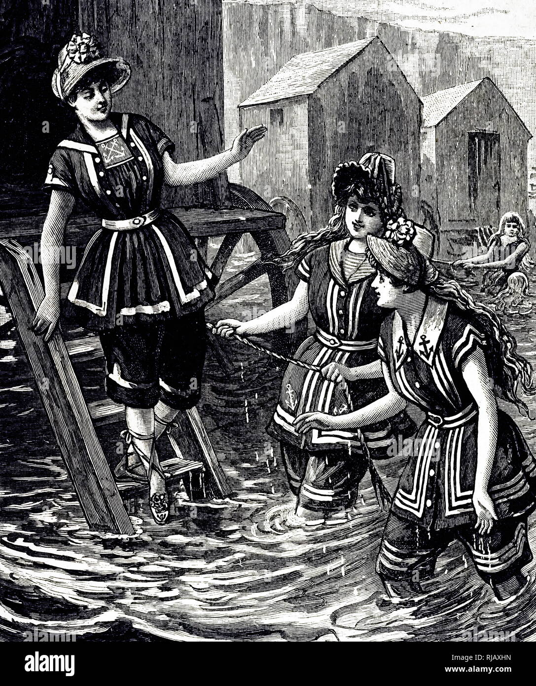 An engraving depicting women wearing bathing costumes of French design. Dated 19th century - Stock Image