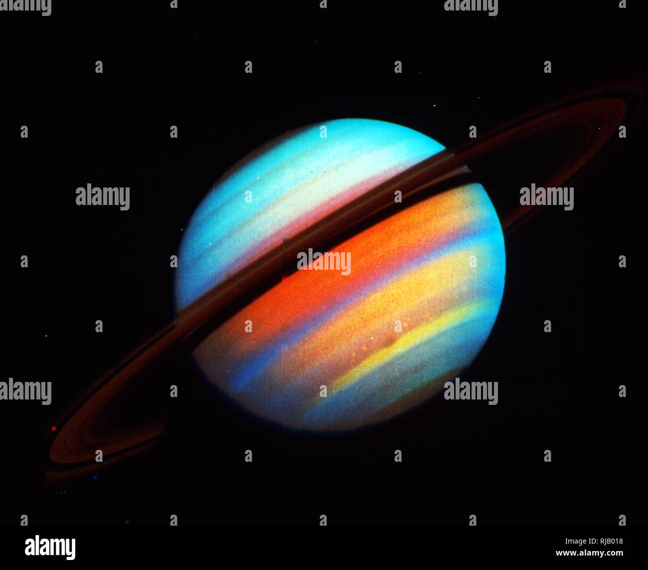 Saturn is the sixth planet from the Sun and the second-largest in the Solar System, after Jupiter. It is a gas giant with an average radius about nine times that of Earth.  It has only one-eighth the average density of Earth. Saturn is named after the Roman god of agriculture; its astronomical symbol (?) represents the god's sickle. - Stock Image