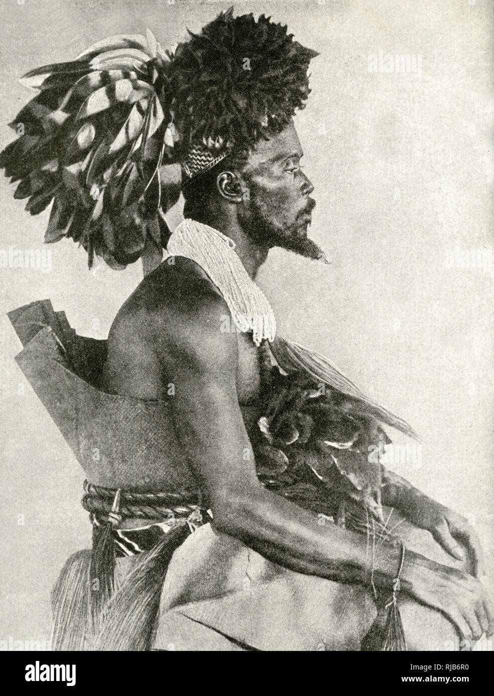 King Akondo of the Mangbettu (Mangbetu) tribe in royal dancing costume, Belgian Congo (now Democratic Republic of the Congo), Central Africa. - Stock Image