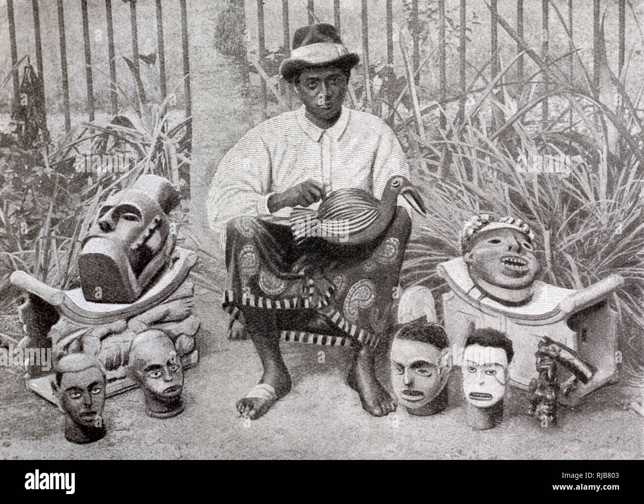 Bantu craftsman of Douala (Duala) making wooden carvings, Cameroon, Central West Africa (at the time a French colony). Stock Photo