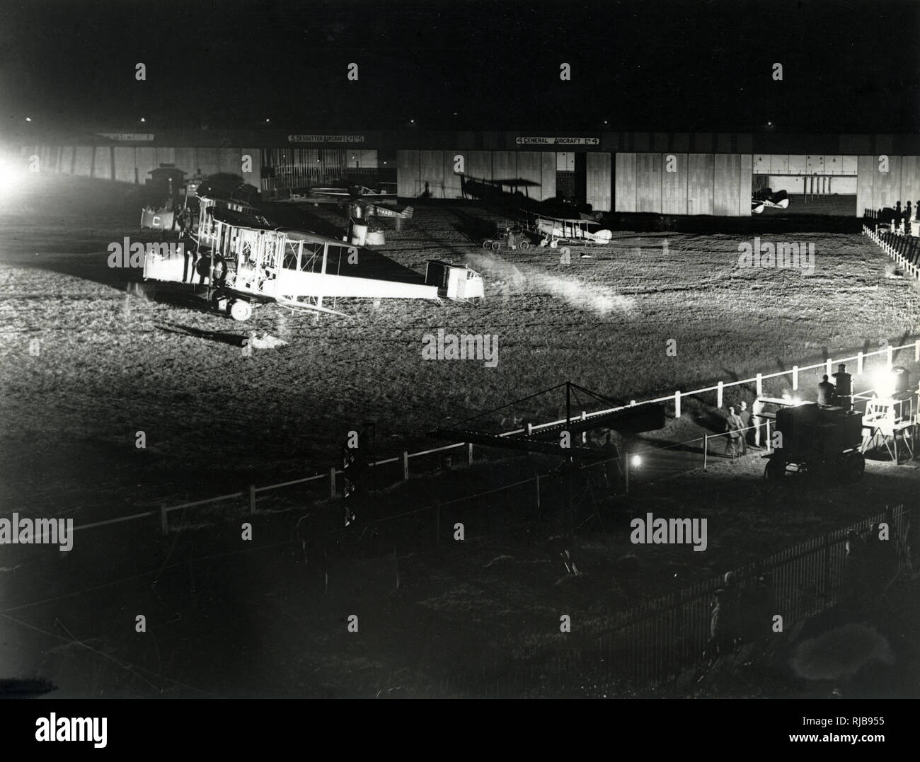 Croydon Airport, Surrey, at night, with hangars in the background. - Stock Image