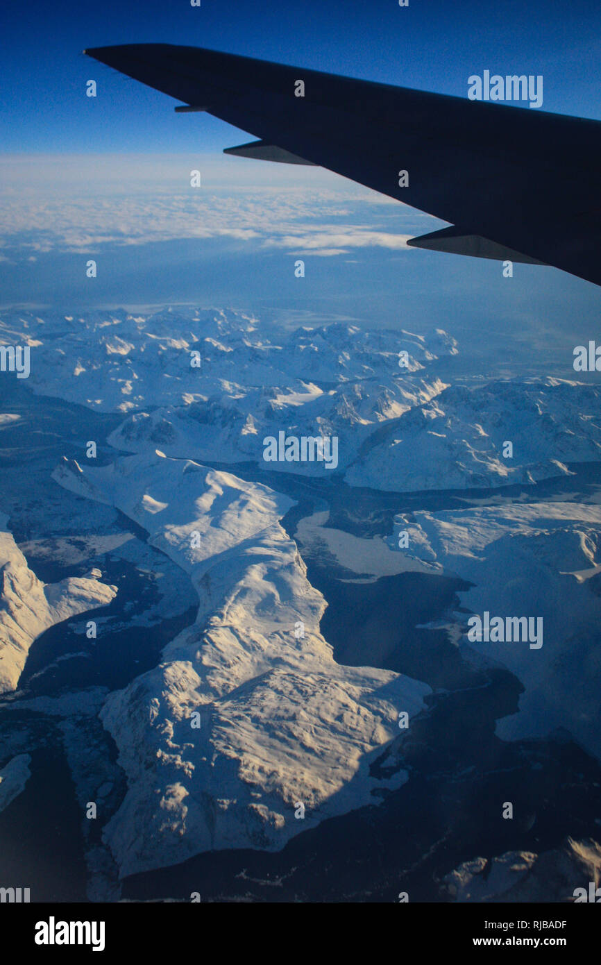 Flying over the bottom of Greenland, on a flight from London Heathrow to Fort Worth Texas - Stock Image