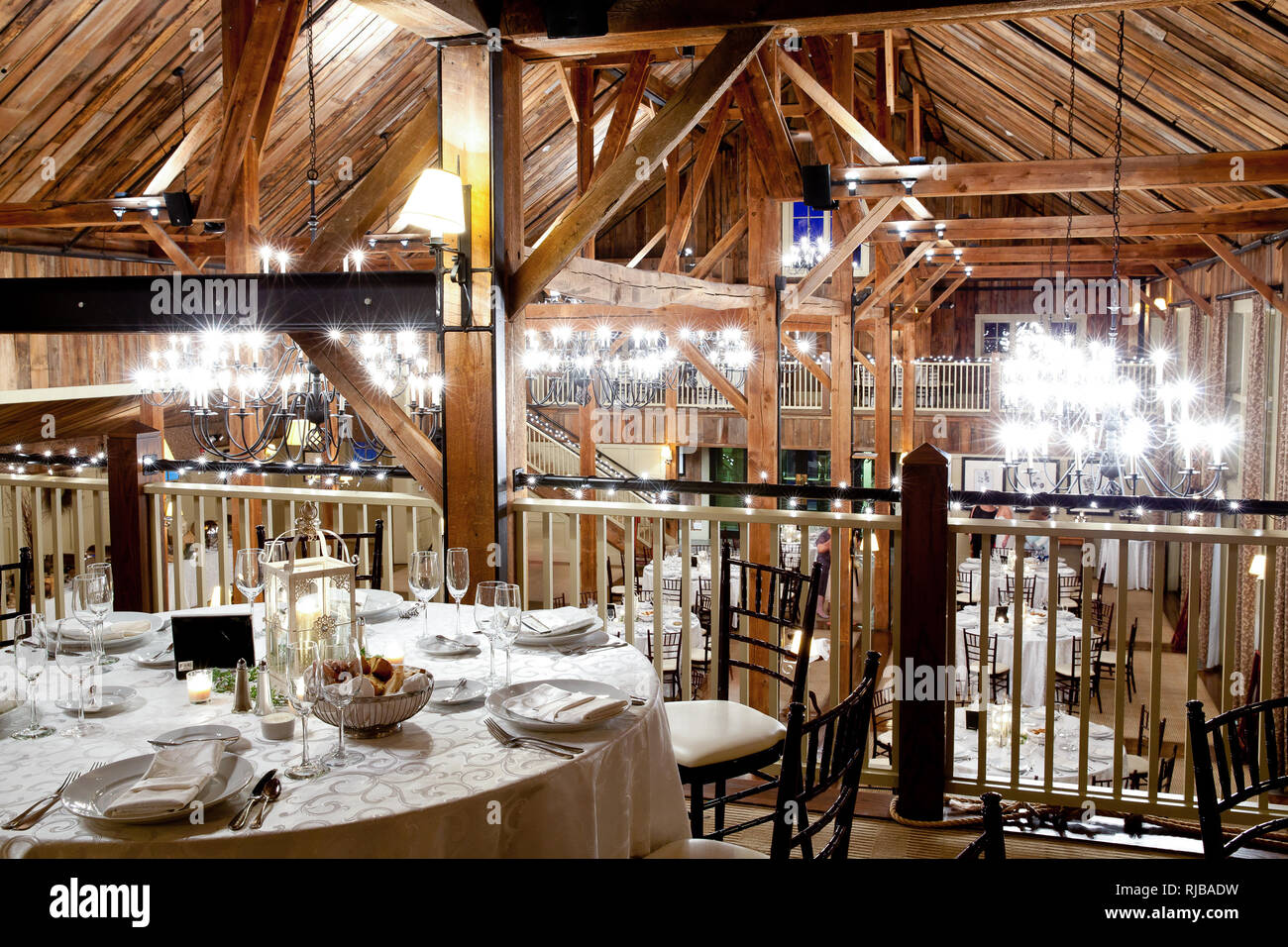 Wedding Tables Set For Fine Dining During A Wedding Reception In A Rustic Old Barn Part Of A Series Of Wedding Photos That Feature Table Settings Stock Photo Alamy