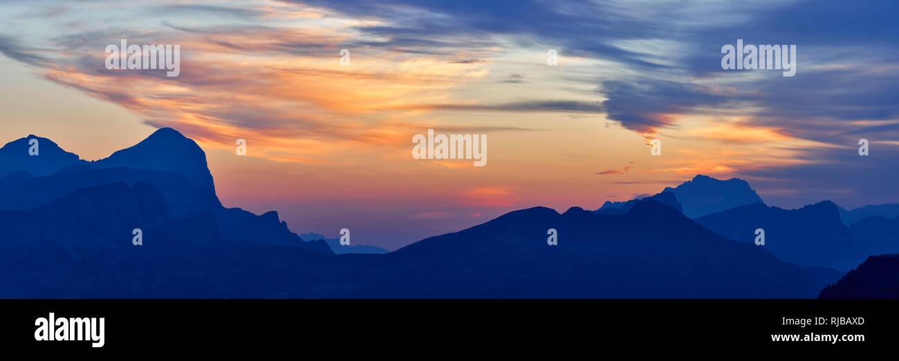 Panoramic view at sunrise of Tofana de Rozes and Monte Civetta from Passo Pordoi, Dolomites, Belluno, Veneto, Italy - Stock Image