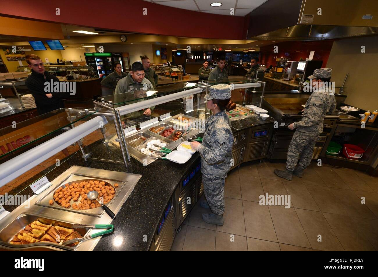Personnel from the 28th Force Support Squadron serve customers breakfast inside the Raider Café at Ellsworth Air Force Base, S.D., Jan. 12, 2018. Having won the Hennessey award several times in the past, an award recognizing the best dining facilities in the Air Force, food service personnel of the 28th FSS gear up to compete in this year's competition. Stock Photo