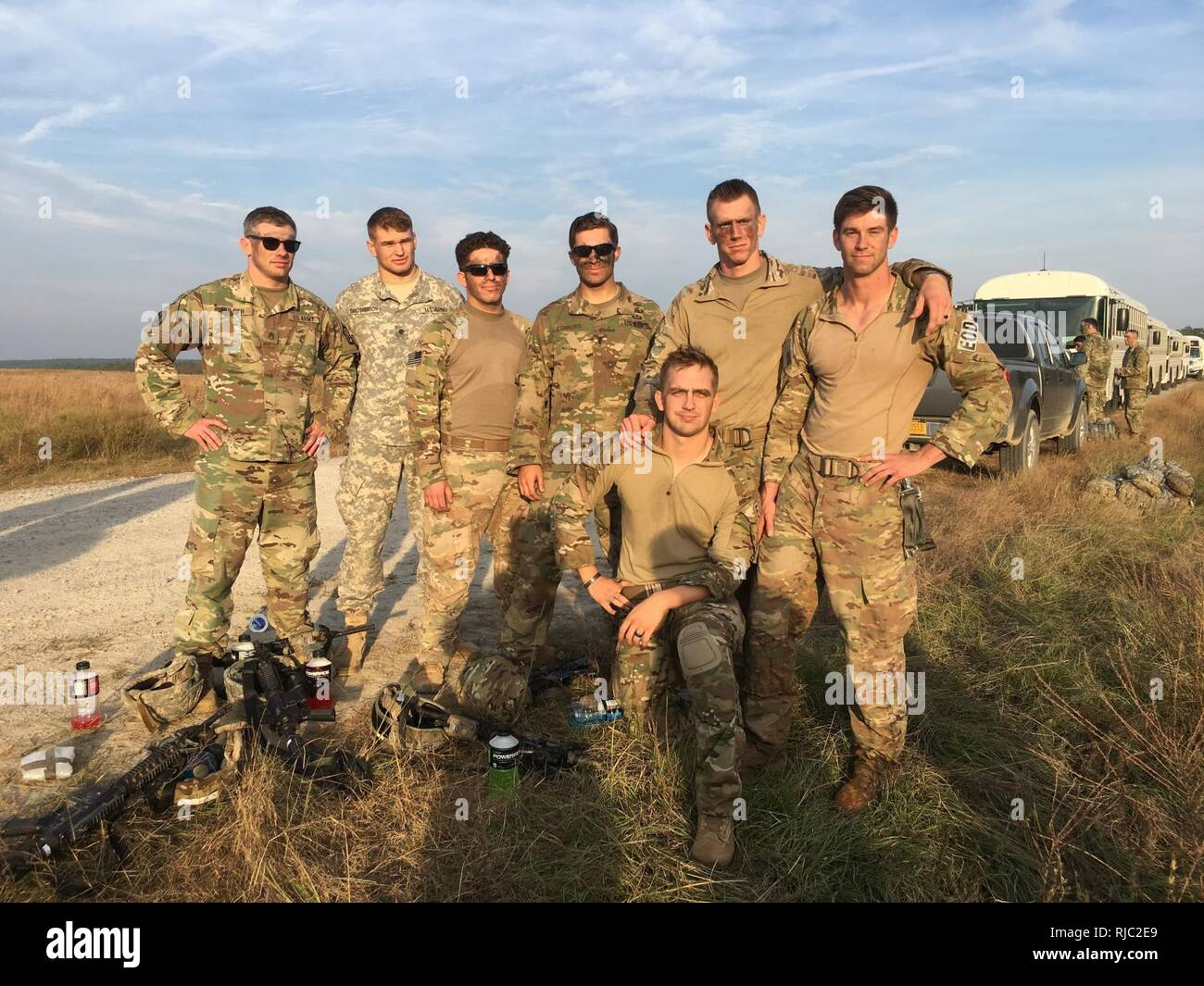 Soldiers from the 767th Ordnance Company (EOD) on Sicily Drop Zone on Nov 3 following the first jump by a conventional explosive ordnance disposal unit with a unit from the 82nd Airborne Division. This is the first collective EOD Airborne operation for the newly designated airborne capable global response force EOD support company. - Stock Image