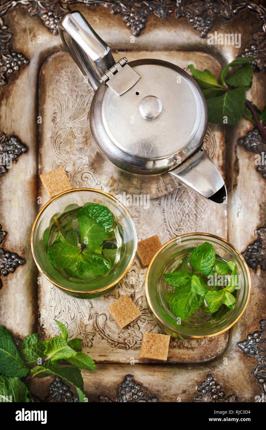 Mint tea with sugar cubes Stock Photo