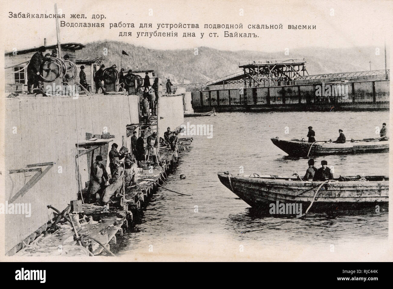 The Trans-Baikal Railway - a subsidiary of the Russian Railways headquartered in Chita and serving Zabaykalsky Krai and Amur Oblast. The mainline was built between 1895 and 1905 as part of the Trans-Siberian Railway. Here, divers are being used to survey the riverbed prior to the construction of a railway bridge. Hazards faced for the tens of thousands of workers employed in the construction of the railway included the complex terrain, crossed by ridges, rivers and swamps, permafrost, low winter temperatures, and natural disasters. Stock Photo
