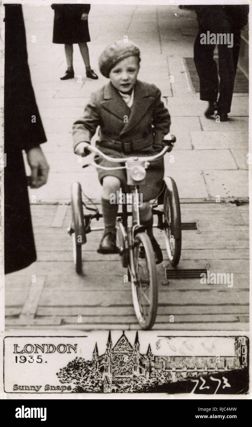 Sunny Snaps Candid postcard photograph - Ladbroke Grove, London - Young boy on a Tricycle - Stock Image