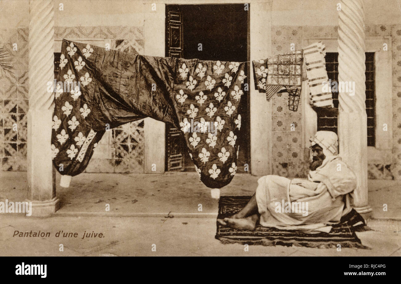 Jewish Lady's Pantaloons - on washing line - Tunisia. Their magnificence quite clearly warrants the personal guard...! Stock Photo