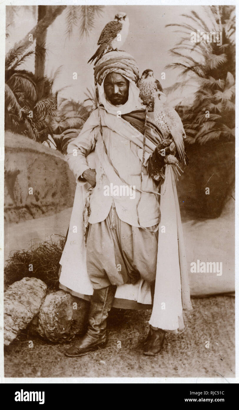 A Magnificent Algerian Falconer with his three birds. - Stock Image