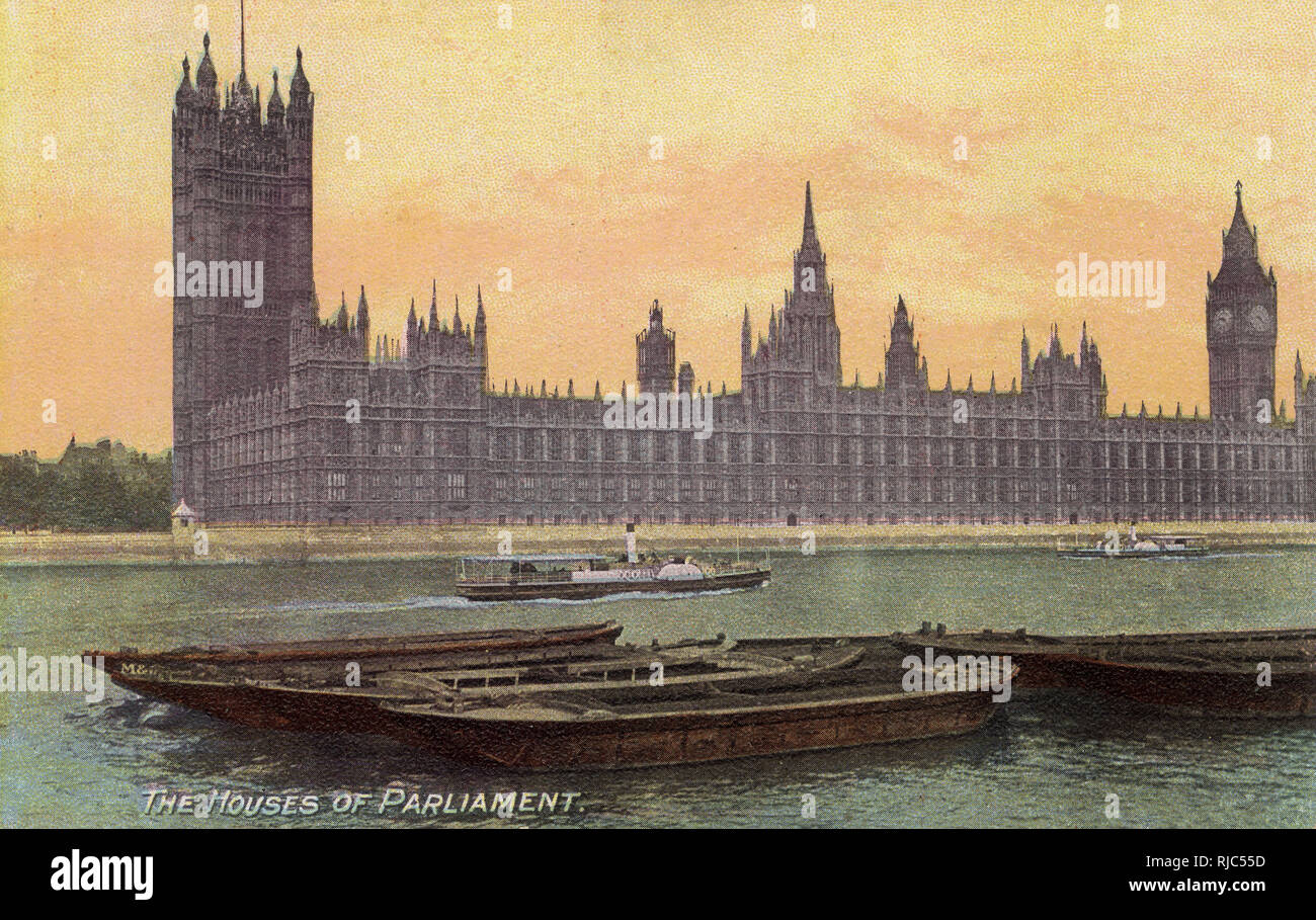 View of the Houses of Parliament, Westminster, London seen from across the River Thames - a small paddle steamer heads heads downstream passed a group of empty moored river barges. Late Afternoon light. - Stock Image