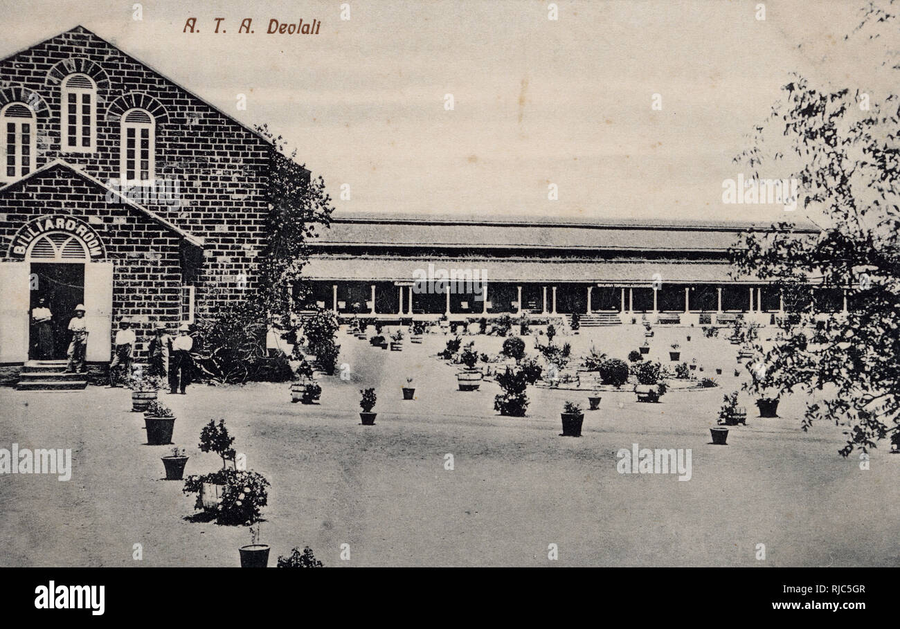 British Garrison at Deolali (Devlali), in Nashik District in the state of Maharashtra, India - British soldiers and Officers outside the Billiard Room. The name of the town is the source of the British slang noun 'doolally tap', loosely meaning 'camp fever', referring to the apparent madness of men waiting for ships back to Britain. By the 1940s this had been shortened to 'doolally'. - Stock Image