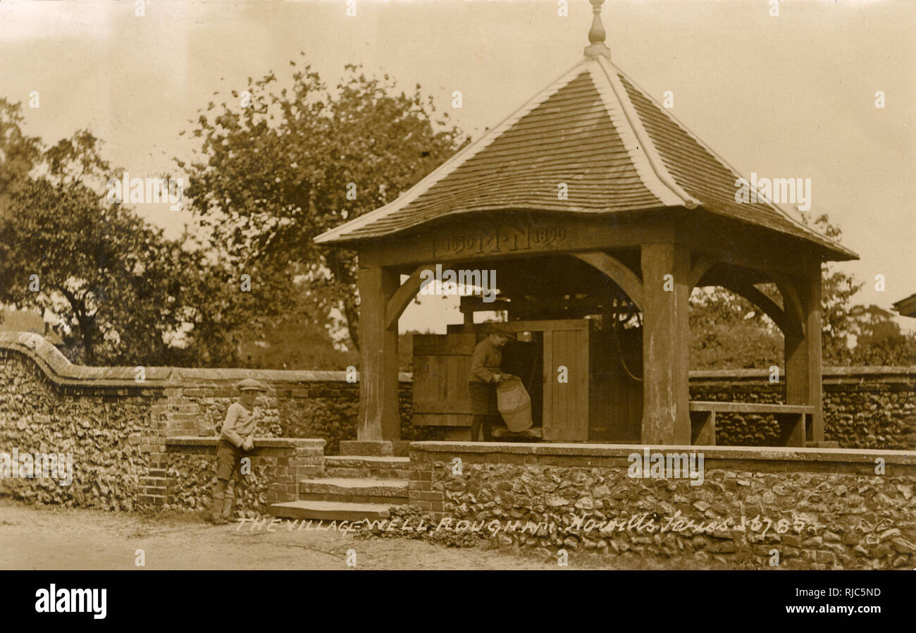 The Street, Rougham, Norfolk - The Covered Village Well - dedicated by (or to) M. N. (1830-1890) - sadly no further information has been found so far... - Stock Image