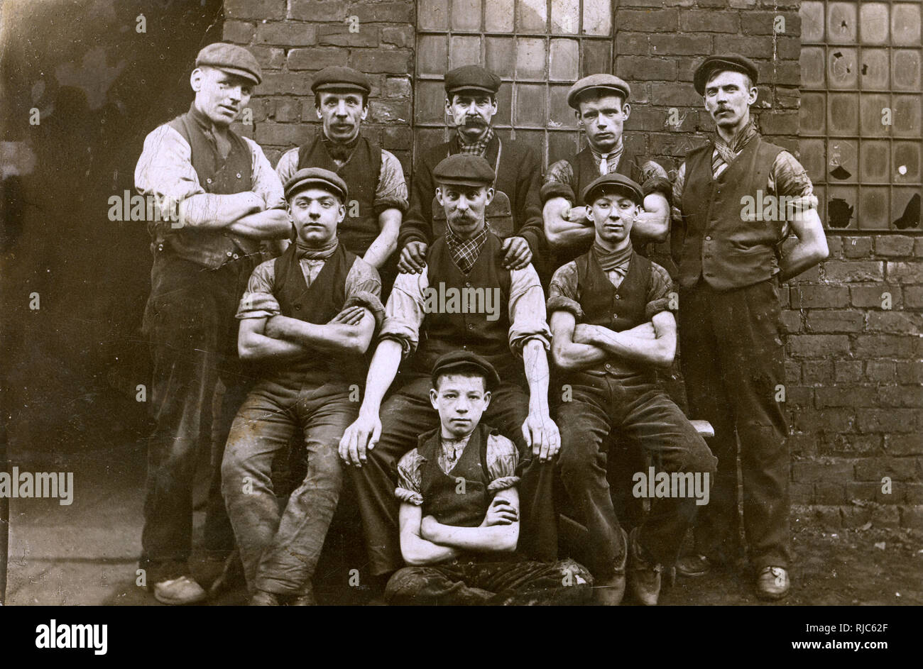 Lancashire engineering factory workers including a very young apprentice (front centre). Stock Photo