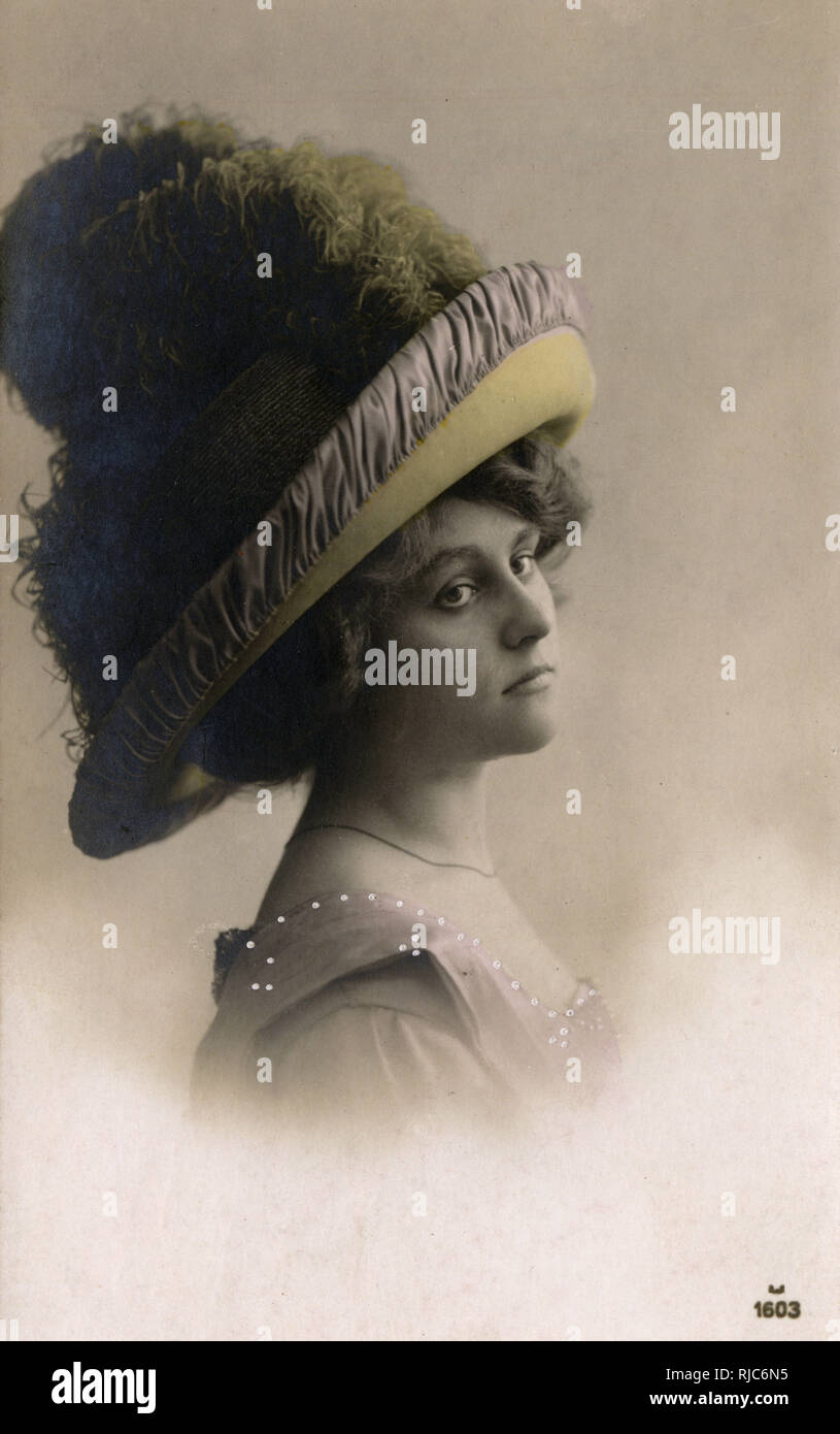 28bbcec1d34 Fashionable Edwardian Style - Pretty model wearing a massive hat with  Ostrich Feathers (dyed olive