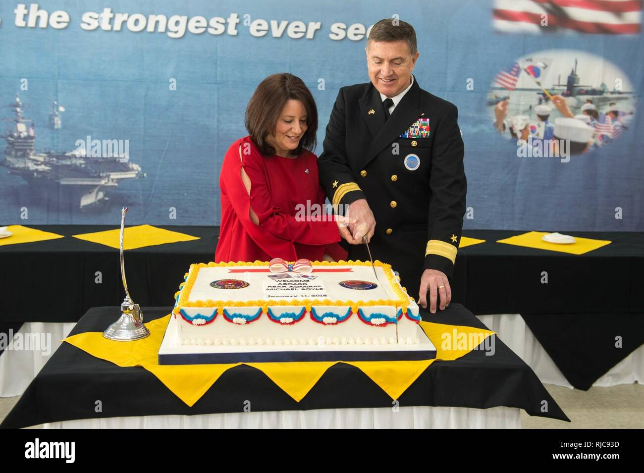 Busan, Republic of Korea (Jan. 11, 2018) Rear Adm. Michael E. Boyle, commander, U.S. Naval Forces Korea, and his wife, Tracy, cut a cake after the change of command ceremony at CNFK headquarters. Boyle relieved Rear Adm. Brad Cooper, becoming CNFK's 36th commander. Stock Photo