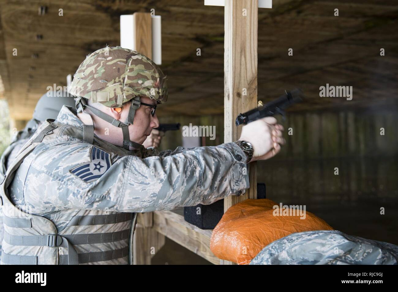 9184d4910b7 U.S. Air Force Staff Sgt. Nathan Parsons shoots the Beretta M9 handgun  downrange as part