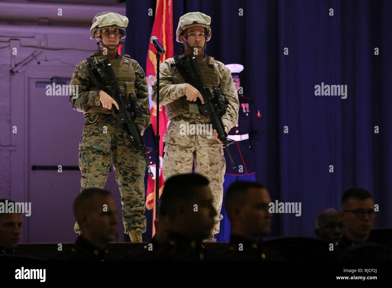 Cpl. Kayla Gilstrap (left) and Lance Cpl. Robert Rocco represent modern day Marines during the annual Historic Uniform Pageant aboard Marine Corps Air Station Cherry Point, N.C., Nov. 4, 2016. The pageant is held to honor the Marine Corps' birthday and features Marines wearing uniforms from all major conflicts the Marine Corps has fought in. The pageant depicts the Corps' long illustrious history throughout decades of warfighting. The pageant also included a traditional cake-cutting ceremony representing the passing of traditions from the eldest Marine to the youngest. - Stock Image
