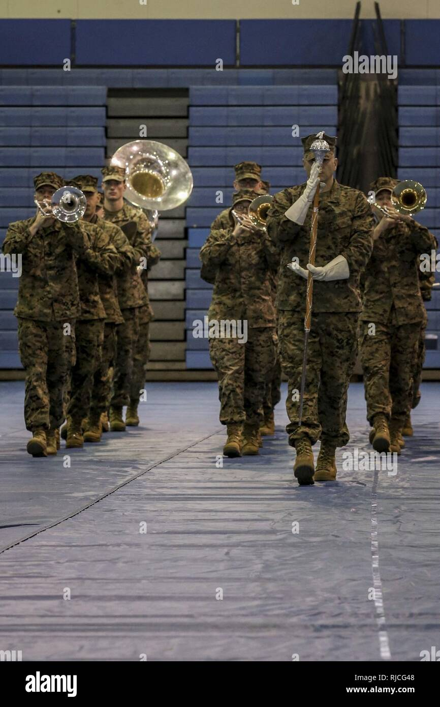 U.S. Marines with the III Marine Expeditionary Force Band perform during a Relief and Appointment ceremony on Marine Corps Air-Station Futenma, Okinawa, Japan, Jan. 11, 2018. Sgt. Maj. Christina A. Grantham relieved Sgt. Maj. Joshua J. Smith as the sergeant major for Marine Air Support Squadron 2. - Stock Image