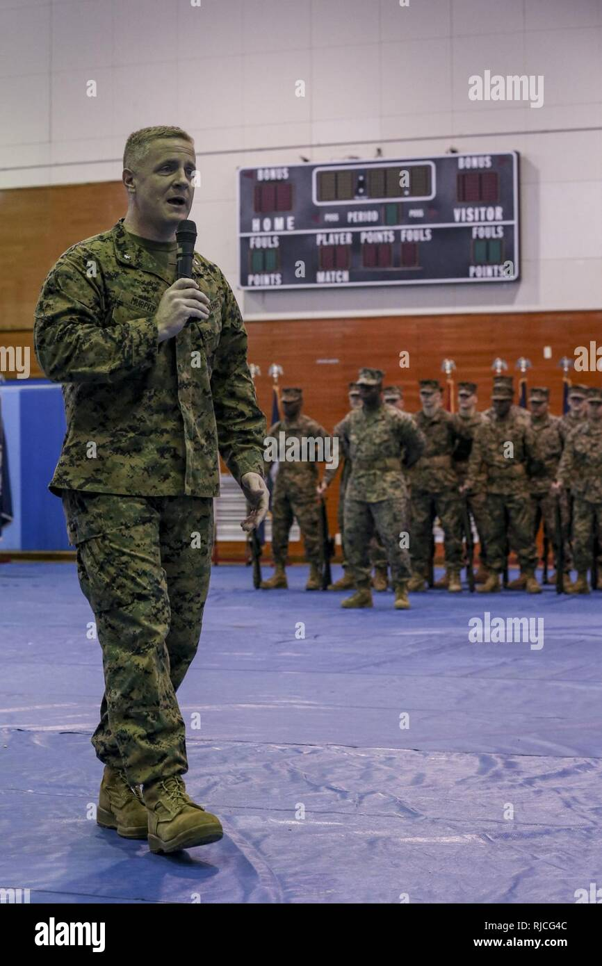 U.S. Marine Corps Lt. Col. Daniel M. Murphy, commanding officer, Marine Air Support Squadron 2 (MASS-2), Marine Air Control Group 18, 1st Marine Aircraft Wing, delivers a speech during a Relief and Appointment ceremony on Marine Corps Air-Station Futenma, Okinawa, Japan, Jan. 11, 2018. Sgt. Maj. Christina A. Grantham relieved Sgt. Maj. Joshua J. Smith as the sergeant major for MASS-2. - Stock Image