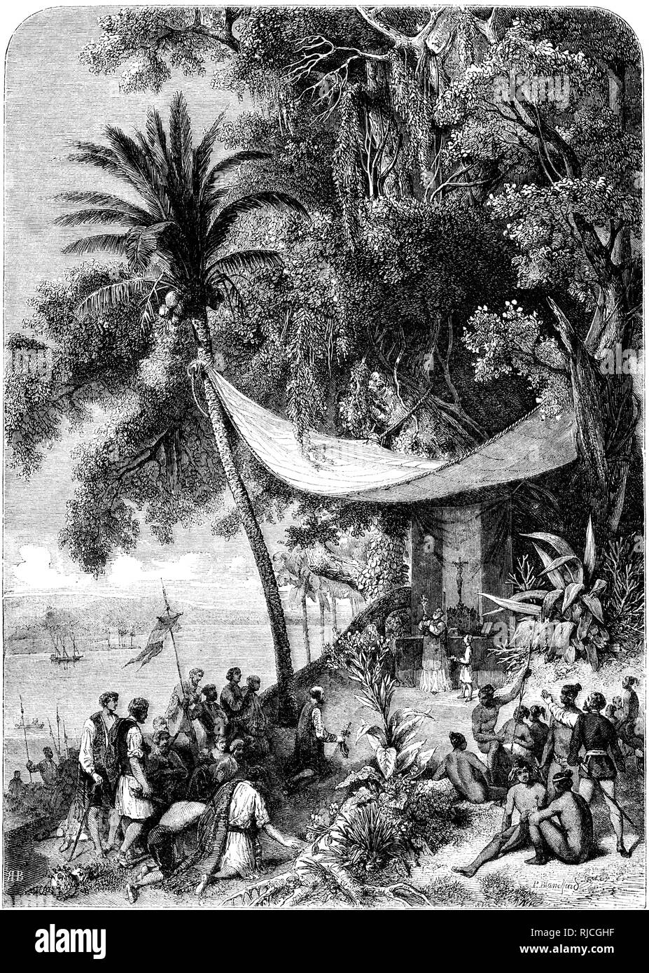 Christopher Columbus' second voyage, the first mass said on American soil. A priest holds up a crucifix as sailors kneel in prayer and to listen, and native people sit in a gathering. Stock Photo