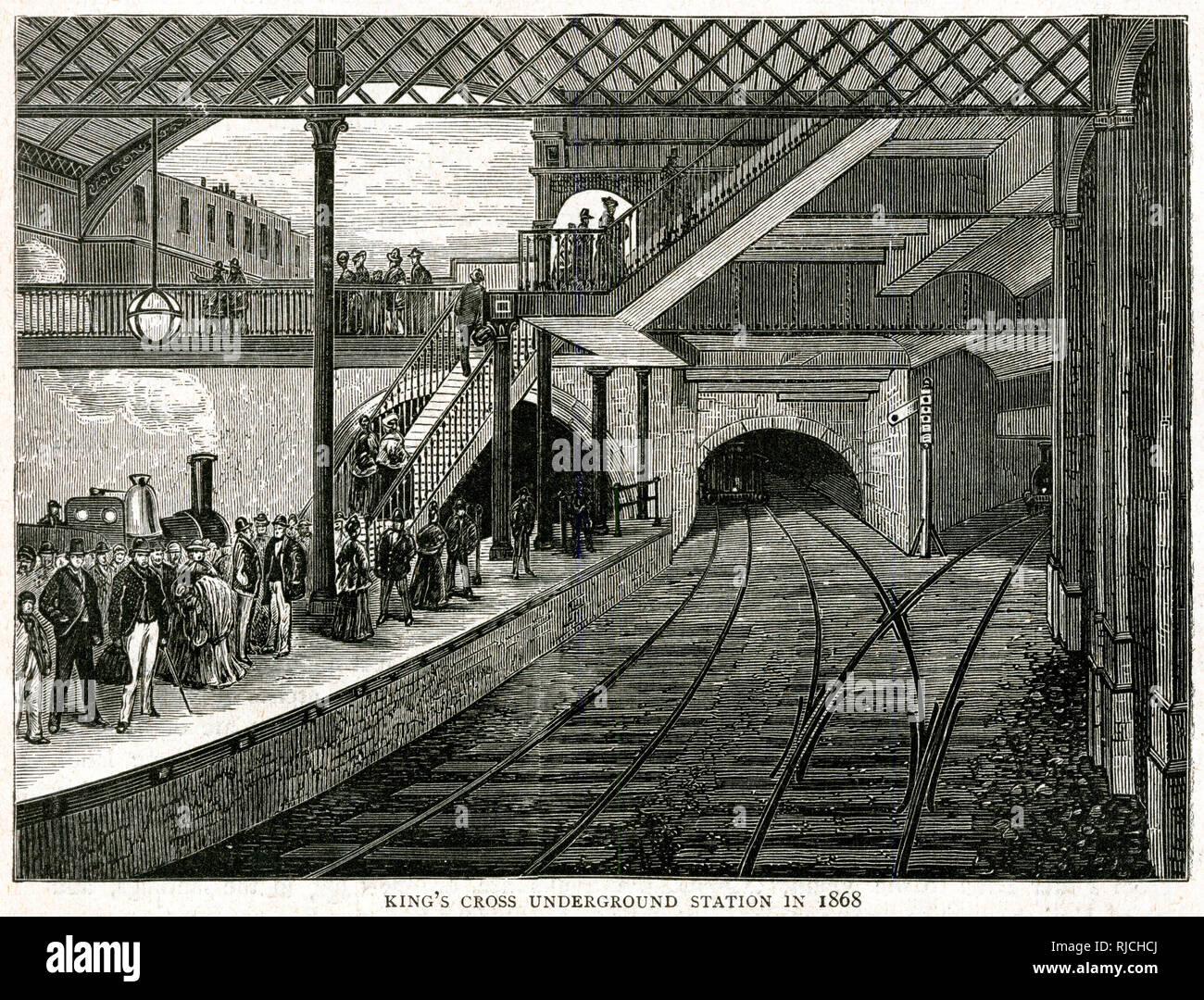 Junction of the Midland, Great Northern, and Metropolitan railways at King's Cross. Part of new work being carried out between King's Cross and Farringdon Road in 1868. - Stock Image