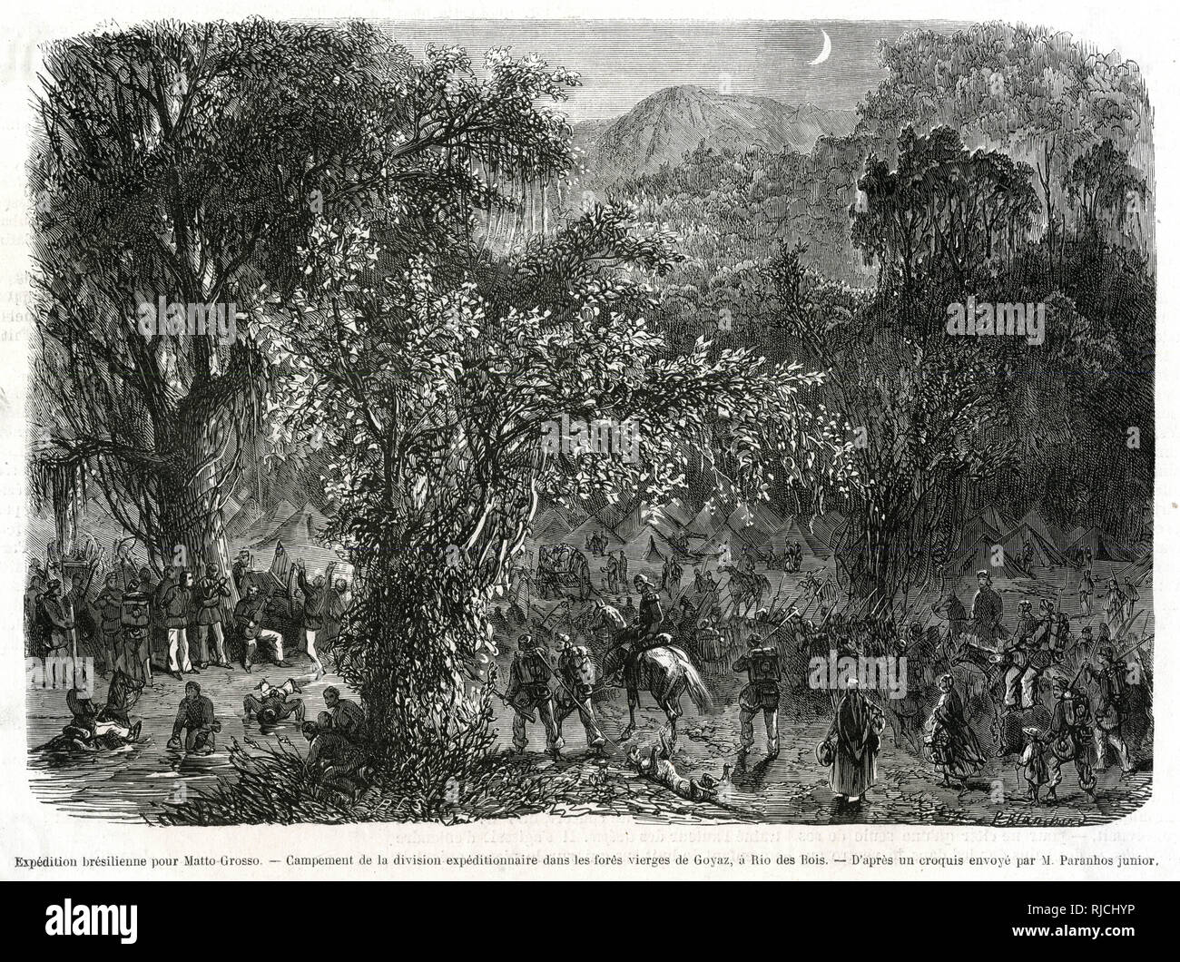 A Brazilian expedition encampment in the forests of Goias, at Rio Verde. An army camp is set up in the distance as a column of soldiers marches into it. Stock Photo