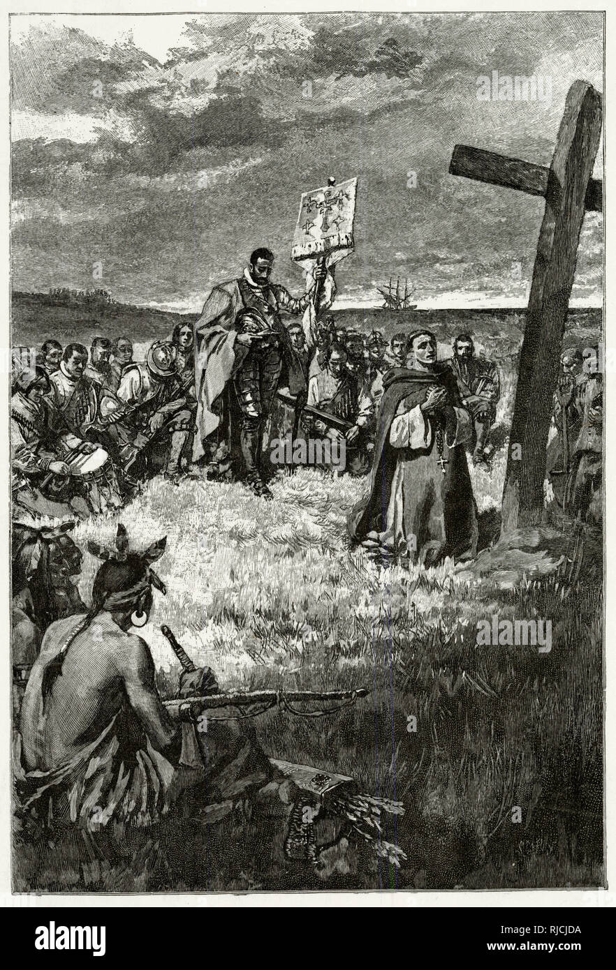 Jacques Cartier sets up a cross at Gaspe. On his exploration of Canada for France, Breton explorer Cartier lands at Honguedo, and is met with the St. Lawrence Iroquoians. A priest kneels in worship in front of a 10 foot high cross Cartier had planted, and Cartier stands behind him, helmet in hand and head bowed, holding a French standard. All expedition members kneel behind him in prayer. 3 Iroquians sit watching the proceedings. Stock Photo