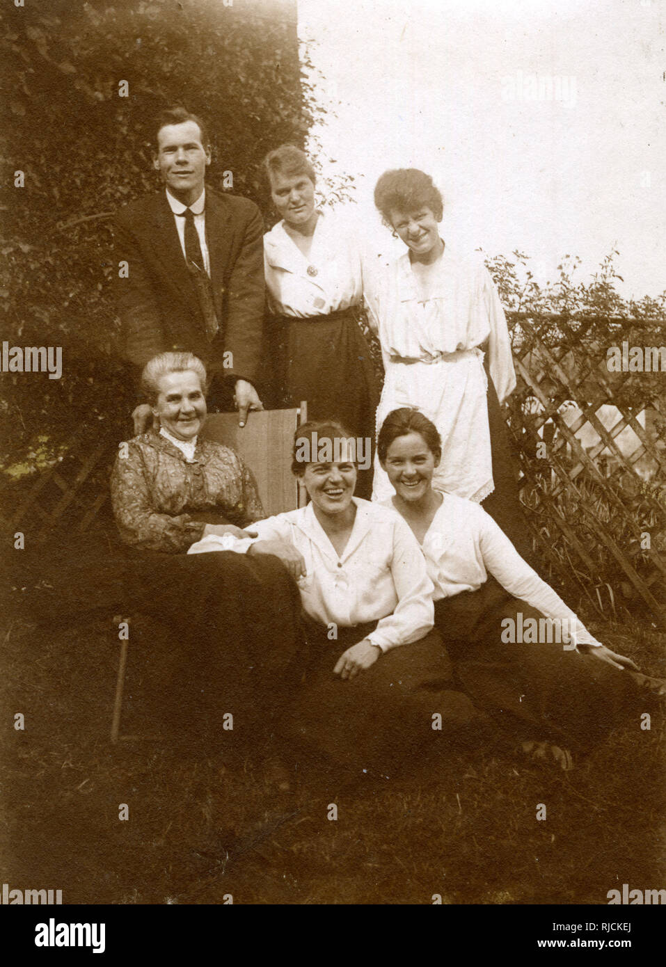 Group photo, family of six in a garden. Stock Photo