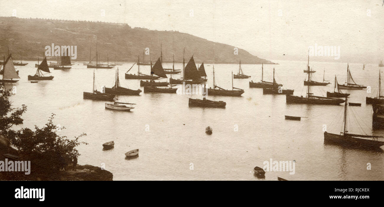 Boats in the shallows at Torquay, Devon. - Stock Image