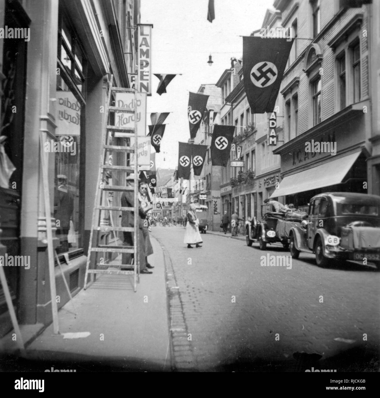 Typical street in Bonn-am-Rhein, Germany, with swastika flags on display. - Stock Image