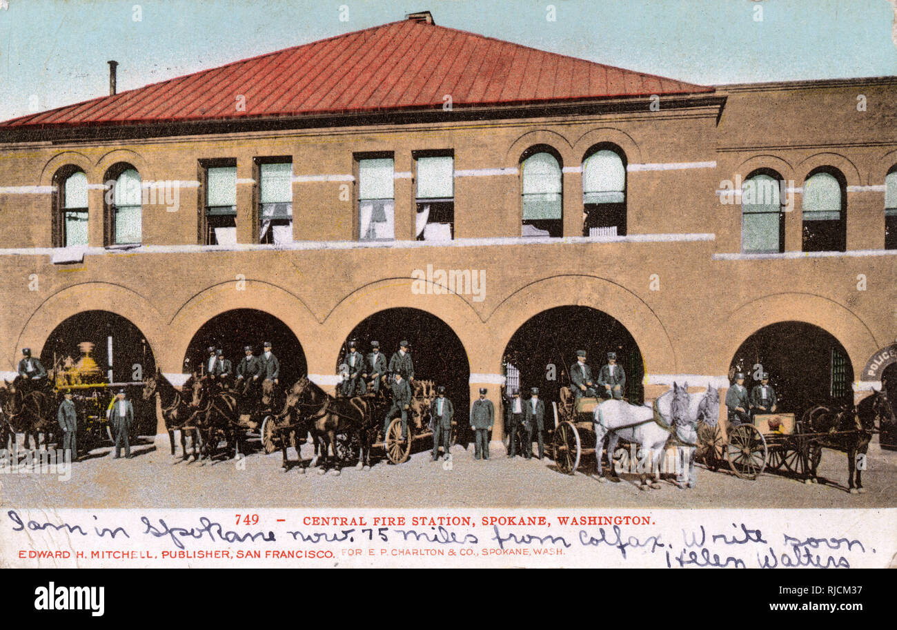 Central Fire Station, Spokane, Washington State, USA, with fire crew and horse-drawn engines. Stock Photo