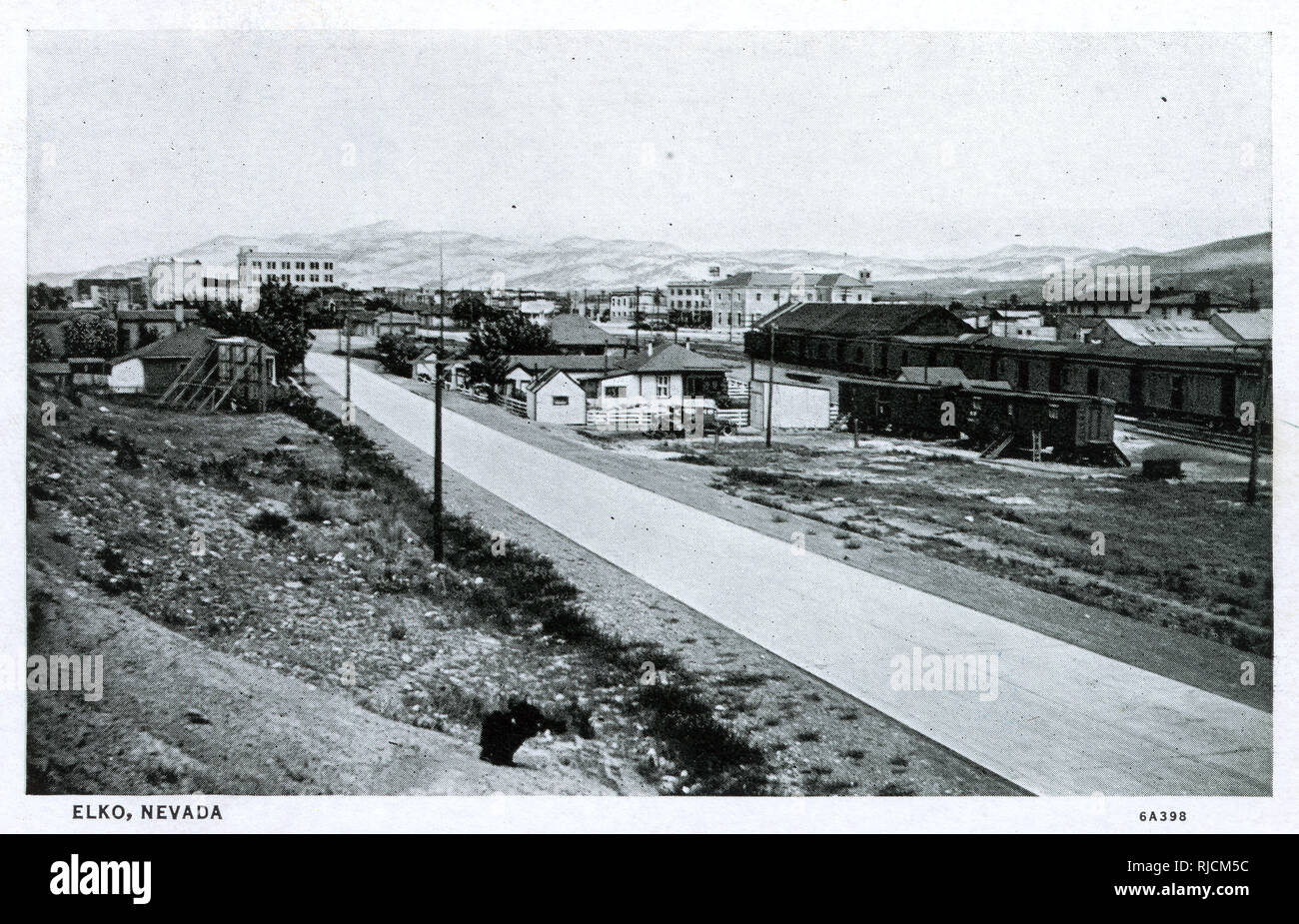 General view of Elko, Elko County, Nevada, USA, with railroad depot and yards. - Stock Image